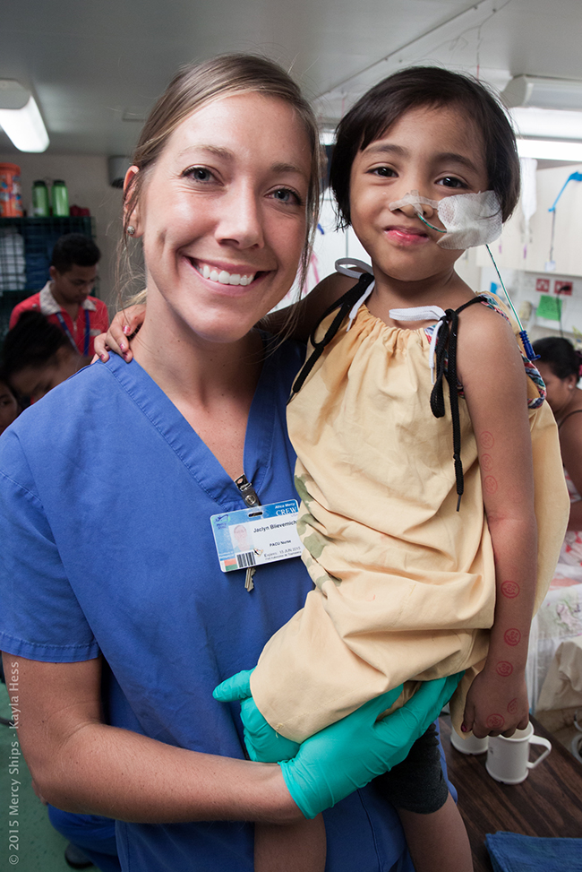 Photo Credit Kayla Hess - Tsanta (MGB16301) plays on D ward with nurse Jaclyn Blievernicht (USA).